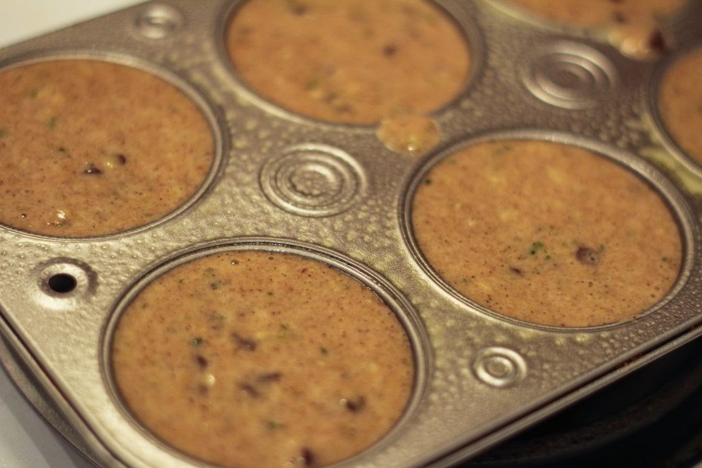 Chocolate zucchini bread batter in muffin baking dish