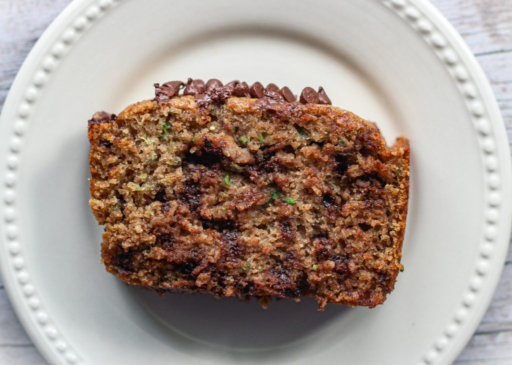 slice of chocolate chip zucchini bread on a plate